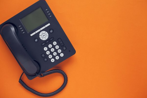 1-voip features voip service black voip phone on orange background
