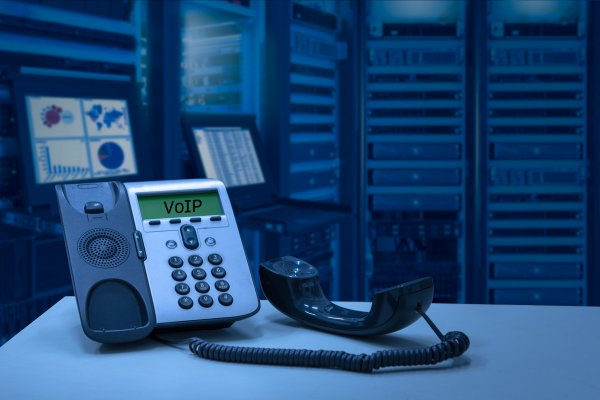 axvoice voip service residential business voip phone on desk servers in the background