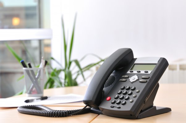axvoice review voip service voip phone in office on desk