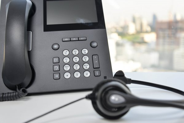axvoice voip service overview headset black phone on desk