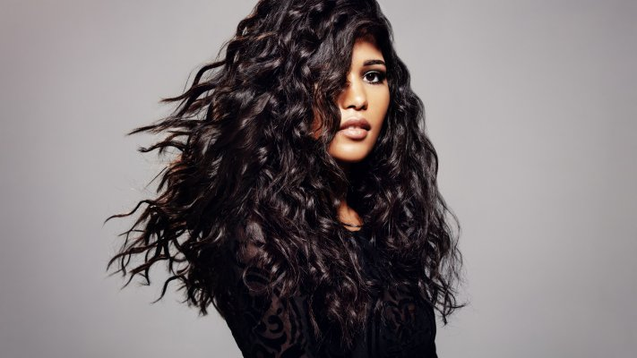 hair dryers best black hair woman with beautiful long black curly hair gray background
