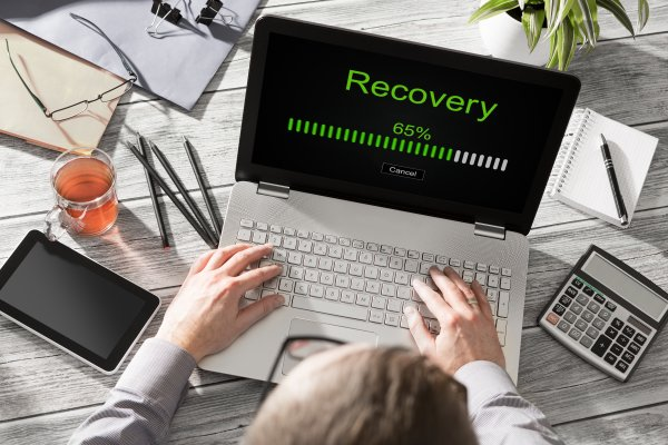 man on laptop recovery bar on screen online backup