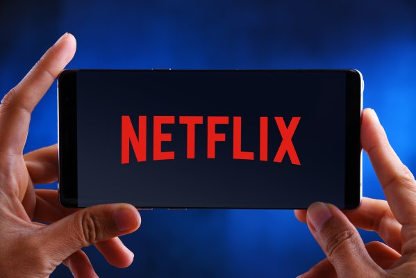 vpn services purevpn unlock netflix streaming services hands holding smartphone with netflix on