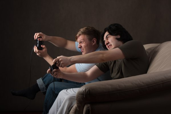 guys men playing video games playstation vpn services