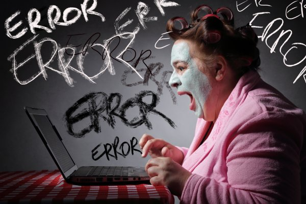 registry cleaners software benefits frustrated woman with face mask on yelling at laptop error written on walls