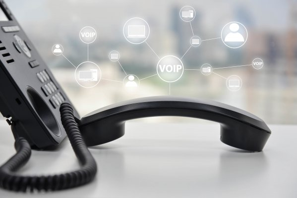 save money voip services benefits black voip phone on desk