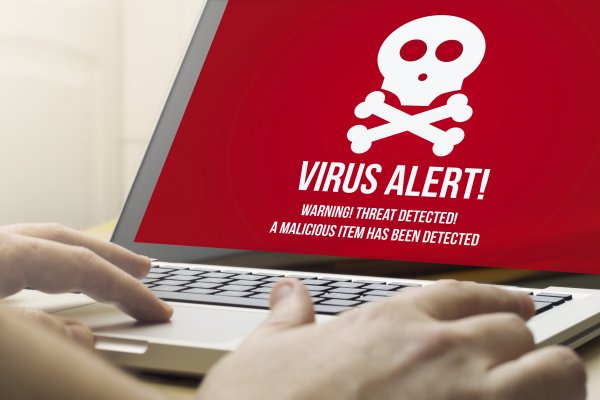 bitdefender antivirus plus 2020 security software red virus alert on monitor display on laptop hands typing