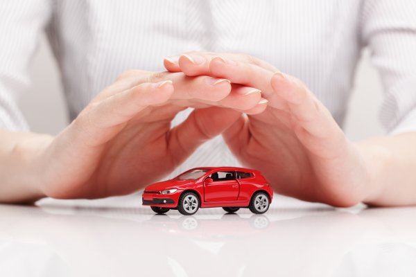 root insurance co root car insurance service hands place above red toy car