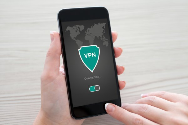 turbovpn android devices vpn service hand holding smartphone connecting to vpn