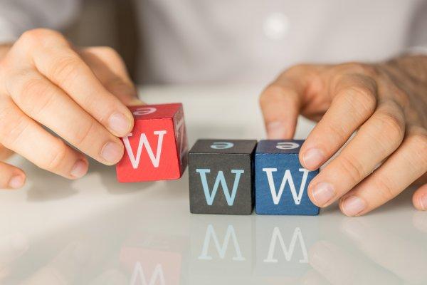 justhost web hosting service review hands holding colored cubes with w letter on them www