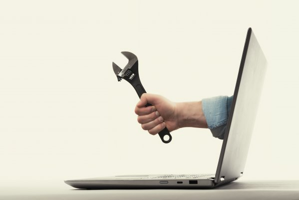 restoro system optimizers hand holding wrench coming out of laptop monitor