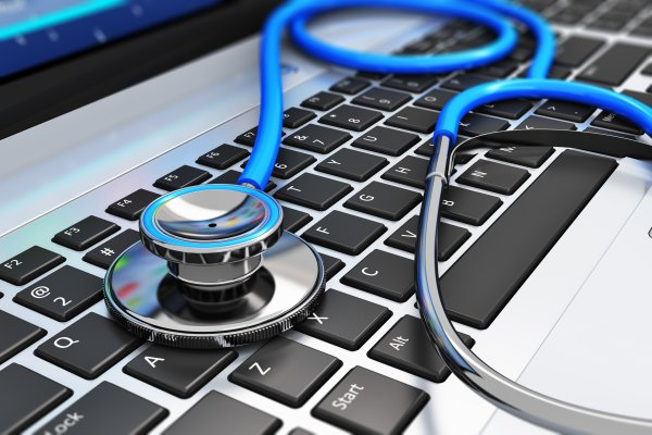 reimage utility software repair software laptop keyboard with stethoscope on it