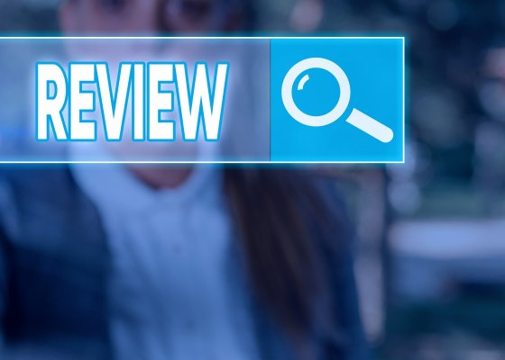 restoro system optimizer review review search bar magnifying glass man blurry in the background