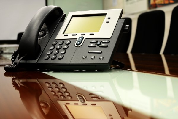 axvoice voip service black voip phone on desk office chairs