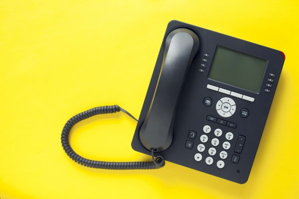 riingcentral voip service black voip phone yellow background