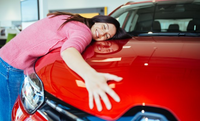car insurance root insurance app features happy woman hugging red car