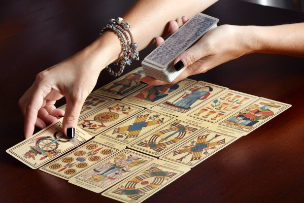 woman tarot cards reading psychic services