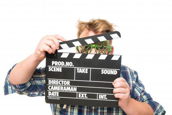 man holding clapperboard video editing software