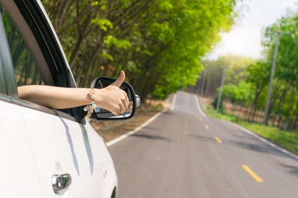 top 10 extended car warranty providers car on the road sunny background hand giving okay sign on the car window