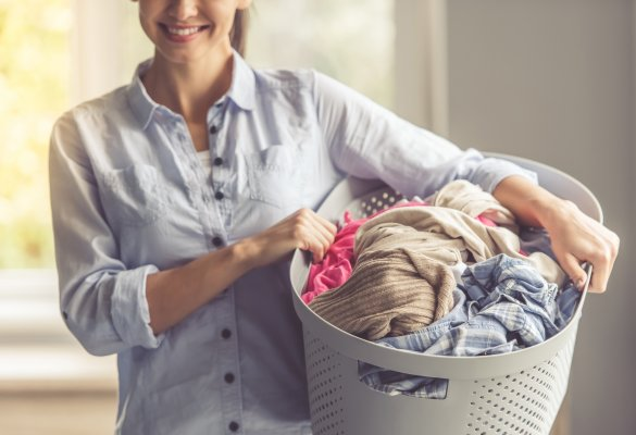 front-load top-load washers washing machines laundry smiling woman with laundry basket