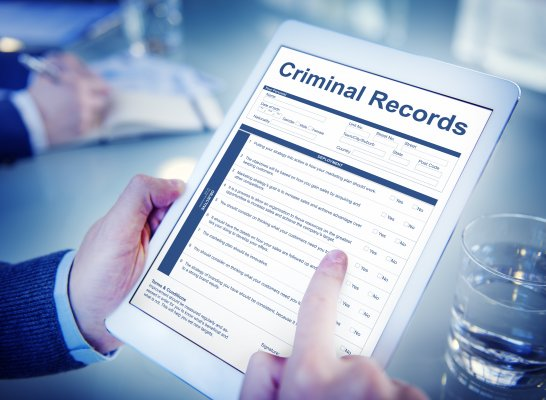 background check services truthfinder cost price how much man holding tablet checking criminal records