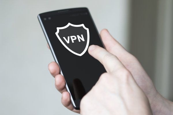 turbo vpn overview vpn services hand holding smartphone vpn on touchscreen