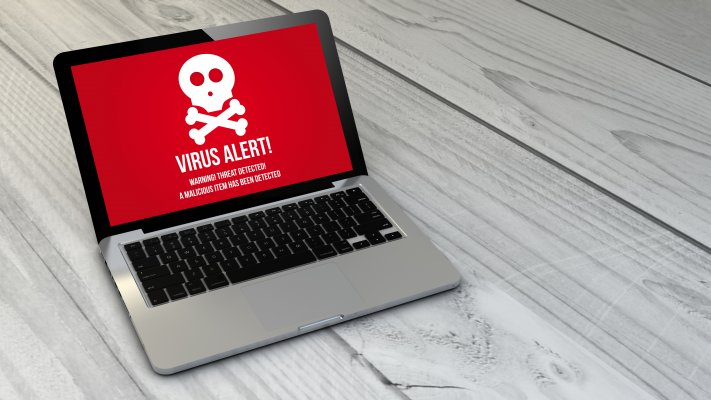 f-secure, antivirus, benefits, software, virus alert on red background on laptop display gray wooden floor