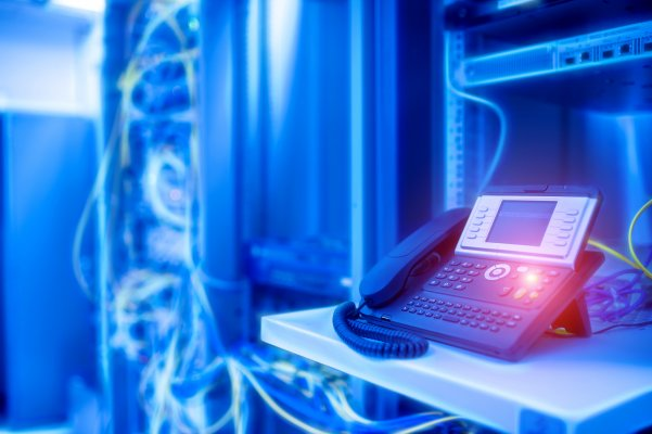 axvoice voip services features voip phone servers in the background