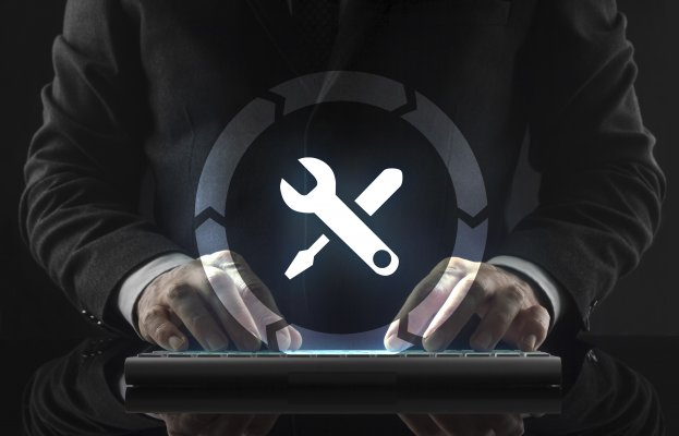 regclean pro registry cleaners software features man in black suit on wireless computer keyboard fixes system wrench and screwdriver symbol in a circle