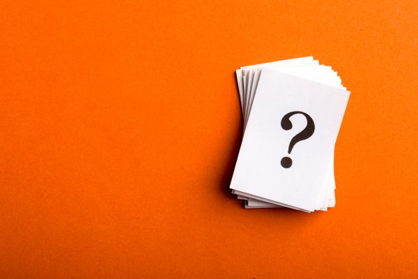 restoro system optimizer question mark on piece of paper orange background