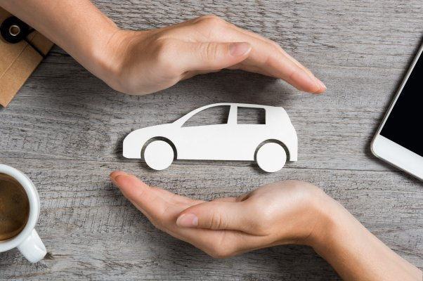 axiom features moxa vehicle service contracts hands protecting white toy car