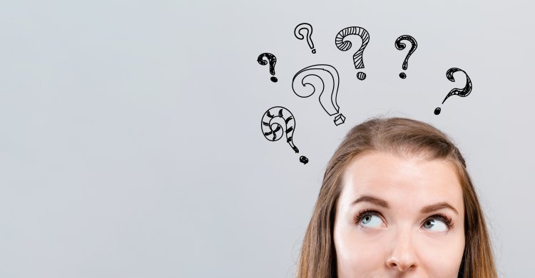 woman wondering question marks above her head gray background system optimizers reimage repair