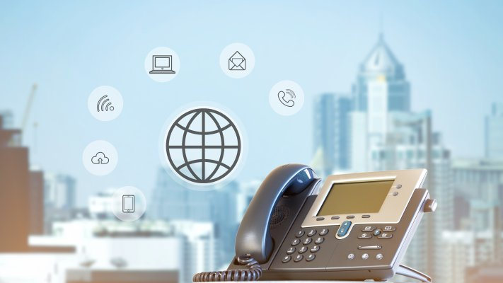 cost price voip service phonepower voip phone city in the background wireless cloud phone call computer icons symbols