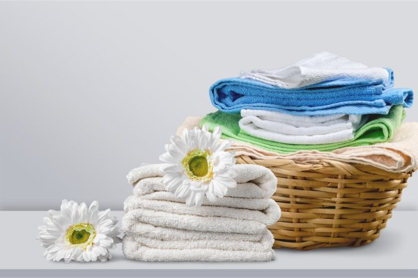 miele washing machine wdb020 eco clean laundry in the basket flowers on towels