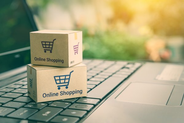 ecommerce shopping cart ashop boxes on laptop online shopping