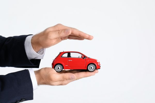 root car insurance features car insurance man in black suit holding red toy car in palm